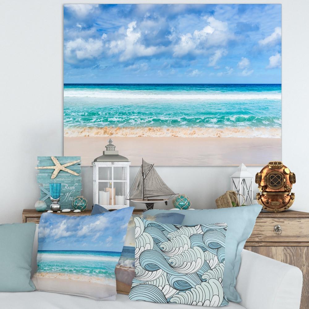 Designart Tranquil Beach under White Clouds - Modern Seascape Canvas Artwork